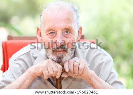 happy senior with cataracts in eyes - stock photo