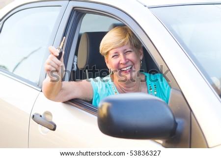 happy senior woman driver inside a car - stock photo