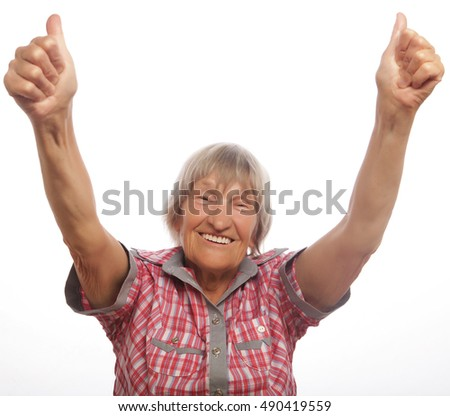 Happy senior woman giving two thumbs up as sign of approval.