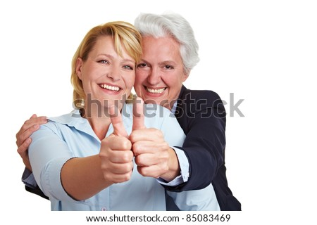 Happy senior woman holding both her thumbs up - stock photo