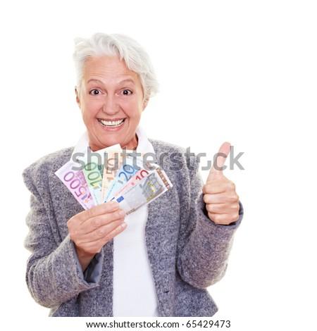 Happy senior woman holding many Euro banknotes - stock photo