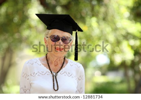 Happy senior woman in graduate cap - stock photo