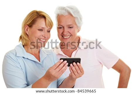 Happy senior woman looking at a smartphone - stock photo