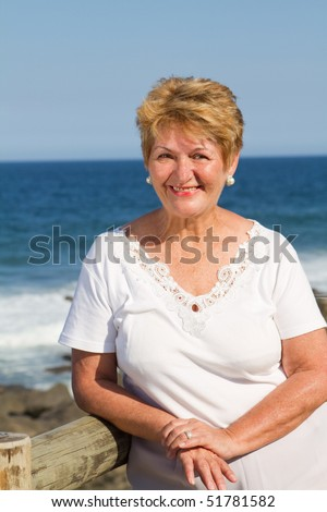 happy senior woman on beach - stock photo
