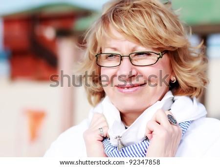 happy senior woman on vacation at sea - stock photo