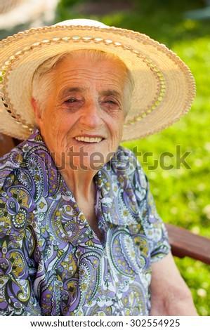 Happy senior woman outdoors - stock photo