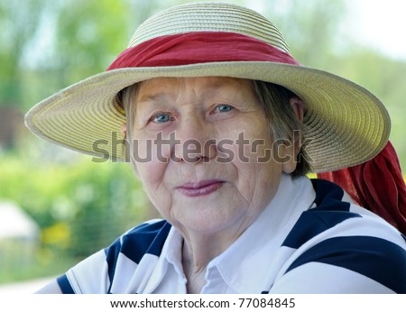 Happy senior woman outdoors in summer - stock photo