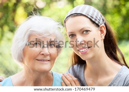 Happy senior woman portrait together with granddaughter - stock photo