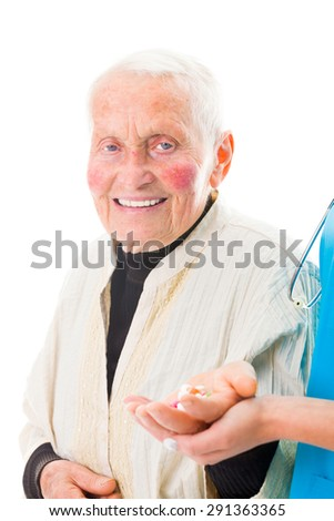 Happy senior woman receiving her meds from the doctor. - stock photo