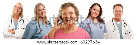 Happy Senior Woman Using Cell Phone with Male and Female Doctors or Nurses Behind Isolated on a White Background.