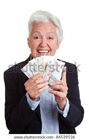 Happy senior woman winning Euro money bills - stock photo