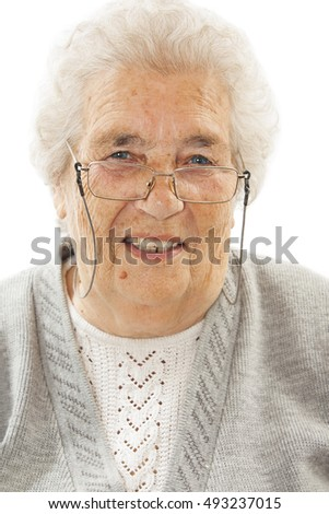 Happy senior woman with a beautiful big smile wearing reading glasses. Isolated on white background