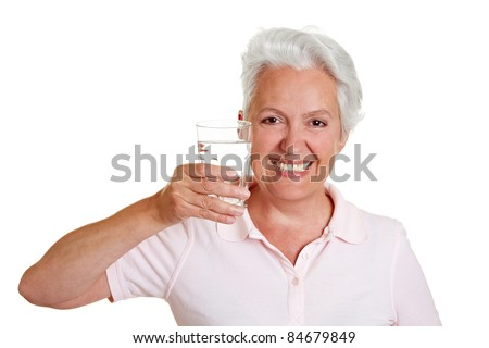 Happy senior woman with a glass of fresh water
