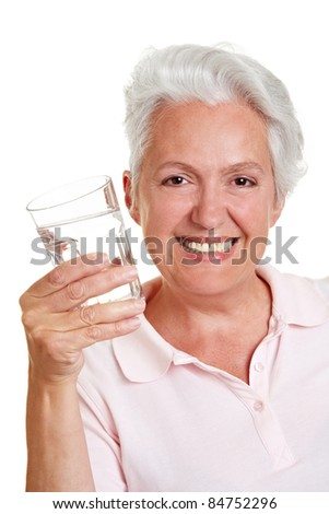 Happy senior woman with a glass of fresh water - stock photo