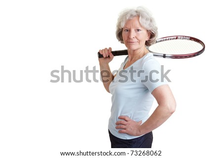 Happy senior woman with a tennis racket - stock photo