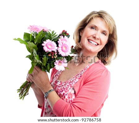 Happy senior woman with bouquet of flowers. Over white background. - stock photo