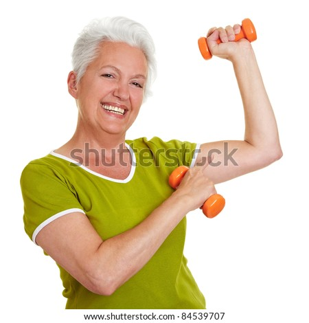 Happy senior woman with dumbbells showing off her muscles - stock photo