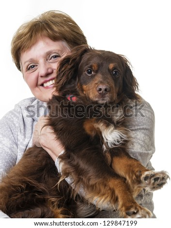 happy senior woman with her dog - stock photo
