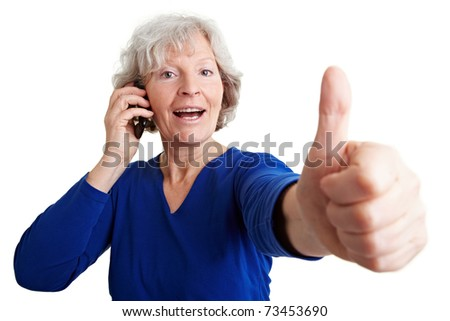 Happy senior woman with mobile phone holding her thumbs up - stock photo