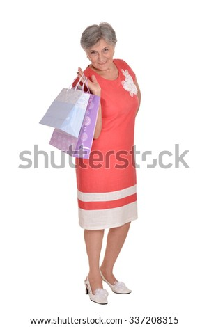 Happy senior woman with shopping bags on white background