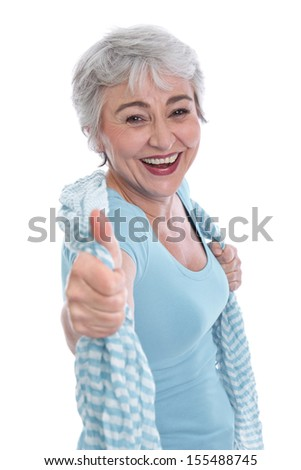 Happy senior woman with thumbs up - stock photo