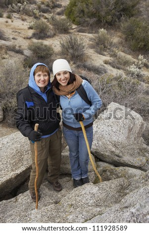 Happy senior woman with young woman on a hiking day