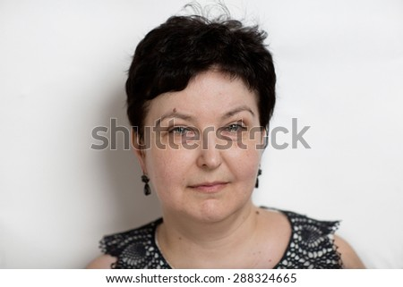 Happy senior woman without anti-age make up, deep wrinkles, spots, tired eyes, slight smile, relaxed face, take care, in-law, mother-in-law. Photo is good for social advertisement about family love. - stock photo