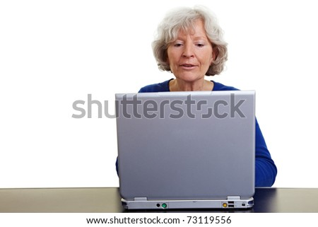 Happy senior woman working on a laptop