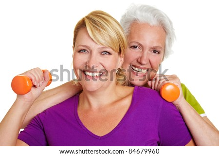Happy senior women making fitness training with dumbbells - stock photo
