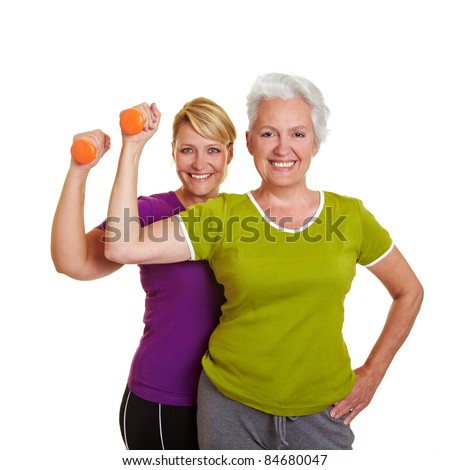 Happy senior women making fitness training with dumbbells