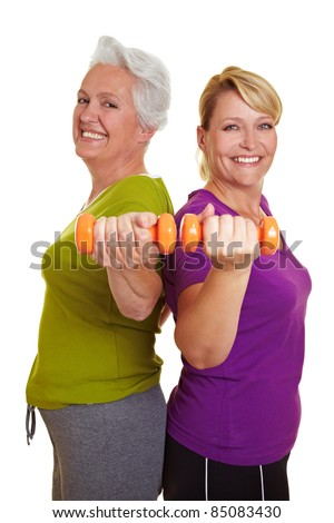 Happy senior women making fitness training with dumbbells - stock photo