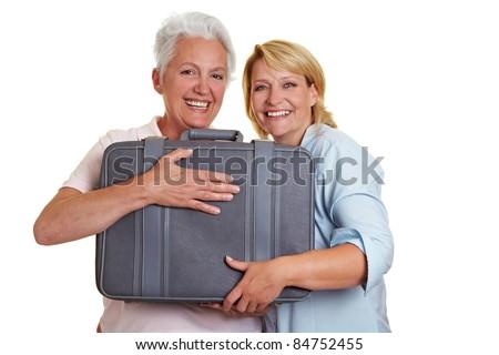 Happy senior women with suitcase on holiday - stock photo