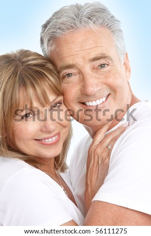 Happy seniors couple in love. Healthy teeth. Over blue background