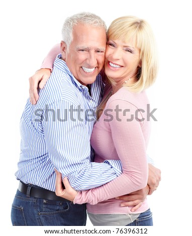 Happy seniors couple in love with flowers.  Isolated over white background - stock photo