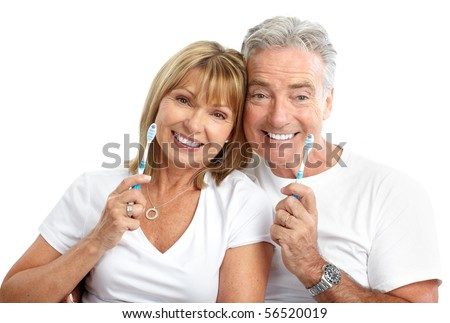 Happy seniors couple with toothbrushes. Healthy teeth. Isolated over white background - stock photo