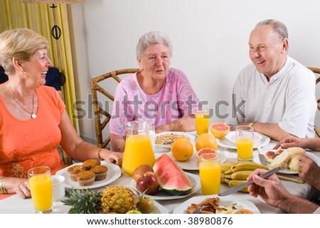 happy seniors friends having breakfast together - stock photo