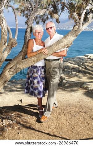happy seniors on holidays - bright lifestyle portrait - stock photo