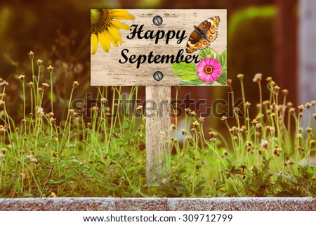 happy september signpost in beautiful woodland with vintage floral meadow filter - stock photo