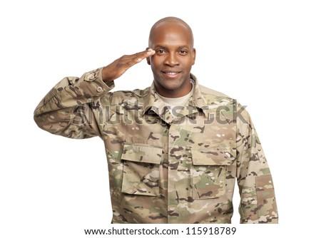 Happy serviceman salutes - stock photo