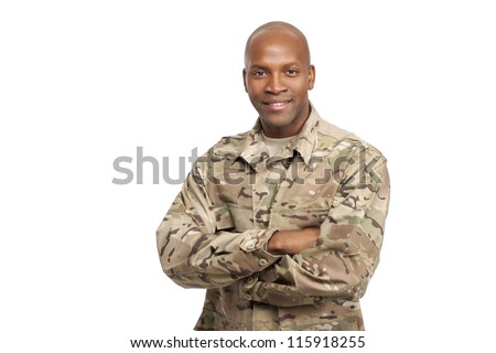 Happy serviceman with his arms crossed - stock photo