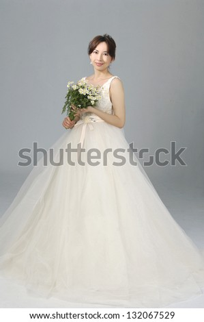 Happy sexy beautiful bride girl in white wedding dress with bright makeup - stock photo