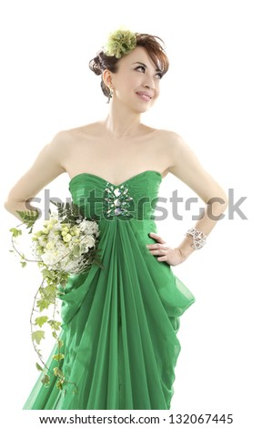 Happy sexy beautiful bride woman l in green wedding dress with hairstyle and bright makeup - stock photo