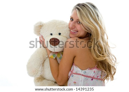 Happy sexy girl with teddy bear on a bedroom isolated on white background - stock photo