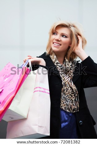 Happy shopper on a street