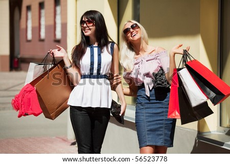 Happy shoppers on a city street. - stock photo