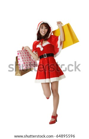 Happy shopping Christmas woman with bags isolated over white. - stock photo