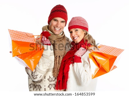 Happy shopping couple with bags. Isolated  white background.