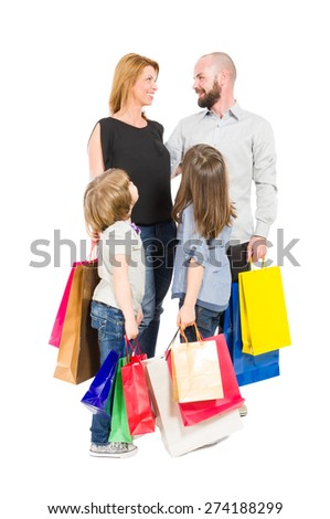 Happy shopping family with shopping bags isolated on white background - stock photo