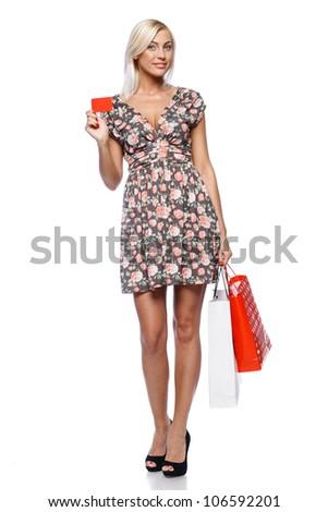 Happy shopping female holding blank credit card. Full length portrait. - stock photo