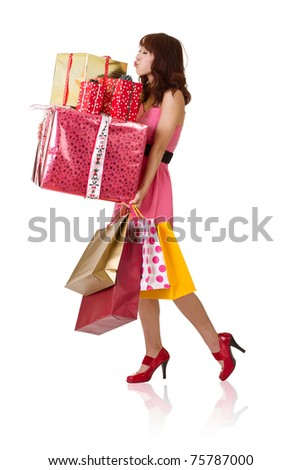 Happy shopping girl holding bags and gift box, full length portrait isolated on white background. - stock photo